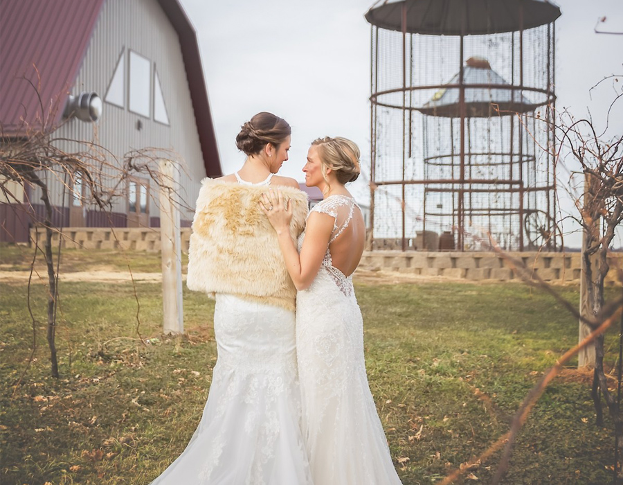 Beautiful brides outside the barn at Pedretti's Party Barn in Viroqua, Wisconsin