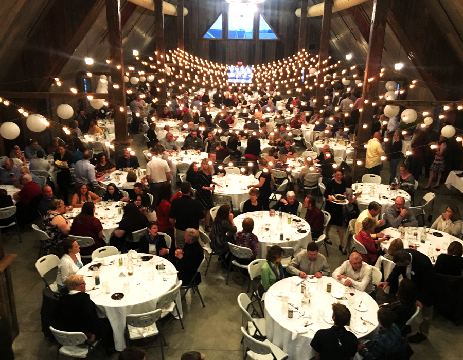 Elegant and rustic non-profit fundraiser dinner inside the barn at Pedretti's Party Barn in Viroqua, Wisconsin