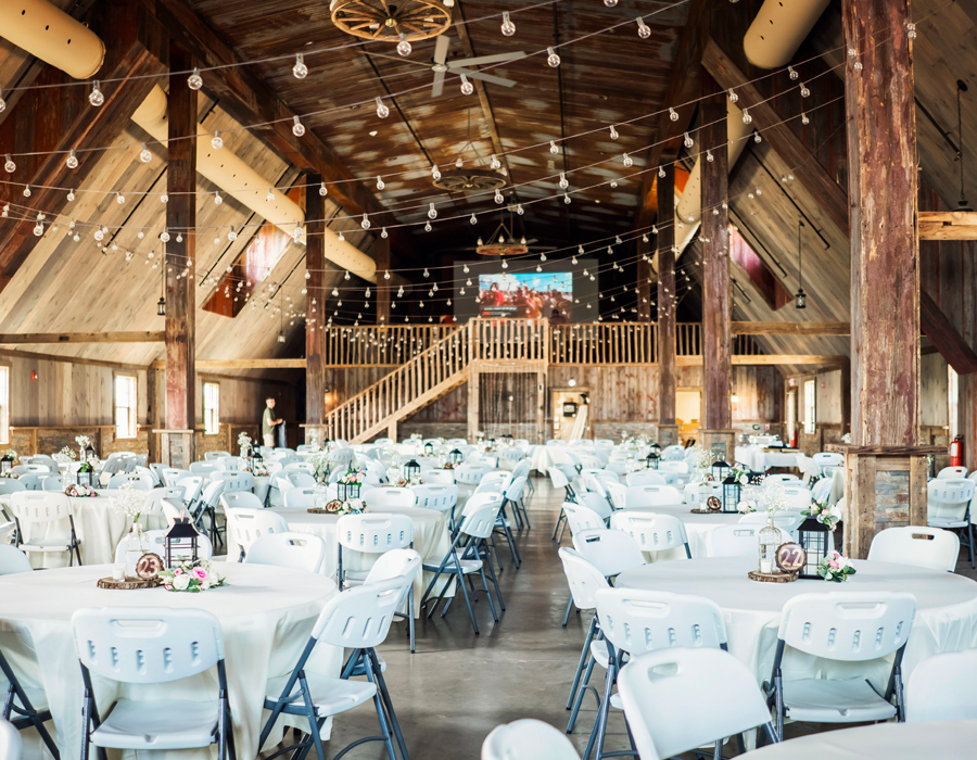 Elegant and rustic reception in the barn at Pedretti's Party Barn in Viroqua, Wisconsin