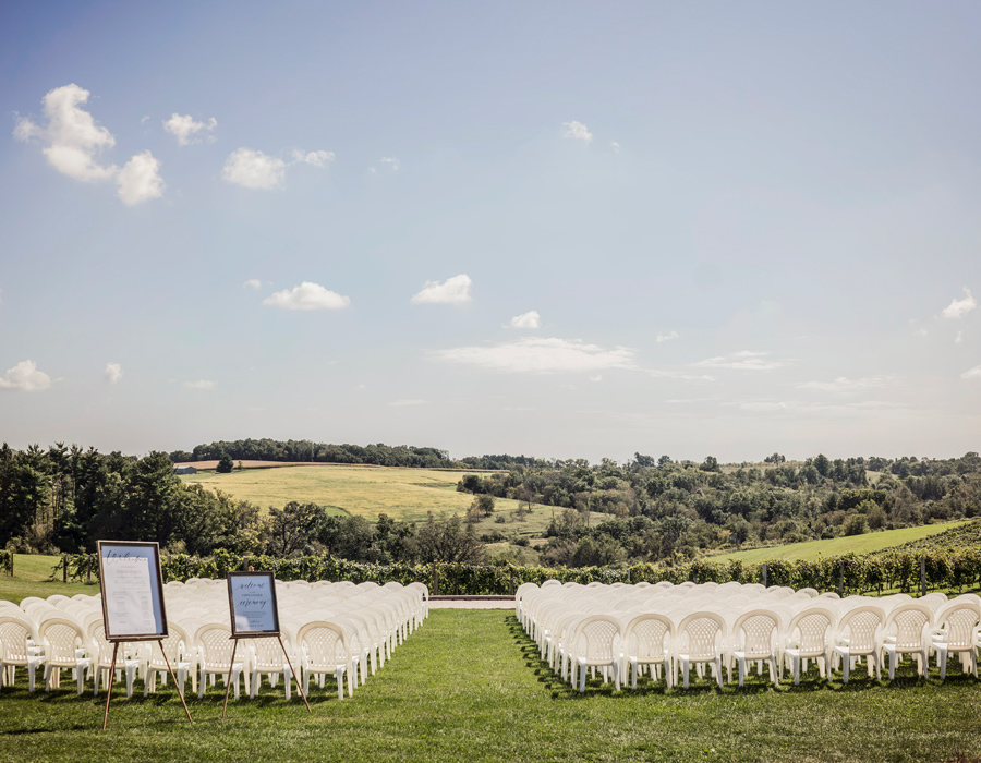 Summer ceremony setup overlooking the vineyard at Pedretti's Party Barn in Viroqua, Wisconsin
