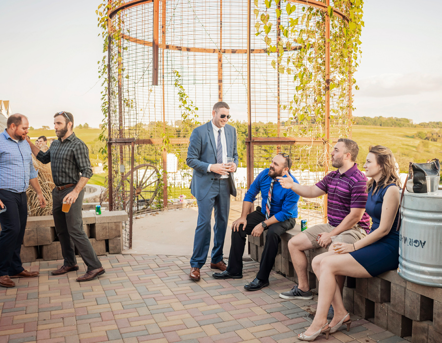 Guests enjoy cocktail hour on paved patio at Pedretti's Party Barn in Viroqua, Wisconsin